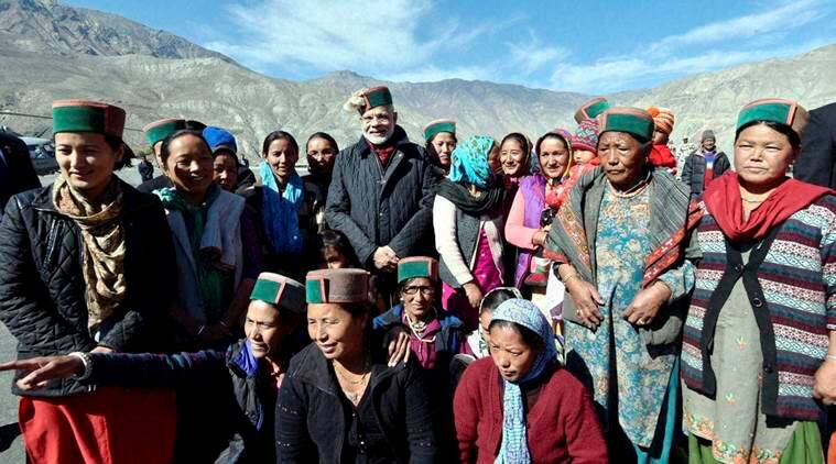 Chango: Prime Minister Narendra Modi greeting the villagers on Diwali at Chango Village of Himachal Pradesh on Sunday. PTI Photo/TWITTER (PTI10_30_2016_000100B)