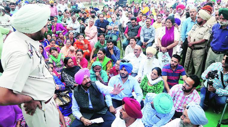 Mohali MLA Balbir Singh Sidhu (in pink turban) on a dharna to protest against GMADA and Punjab government in  Sector 62, Mohali, on Monday.  Jasbir Malhi