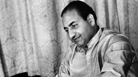 Playback singer Mohammad Rafi playing harmonium. Express archive photo by Mohan Wagh