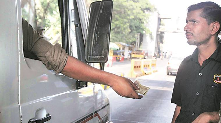 A driver pays toll at Mulund toll naka on Wednesday. Deepak Joshi