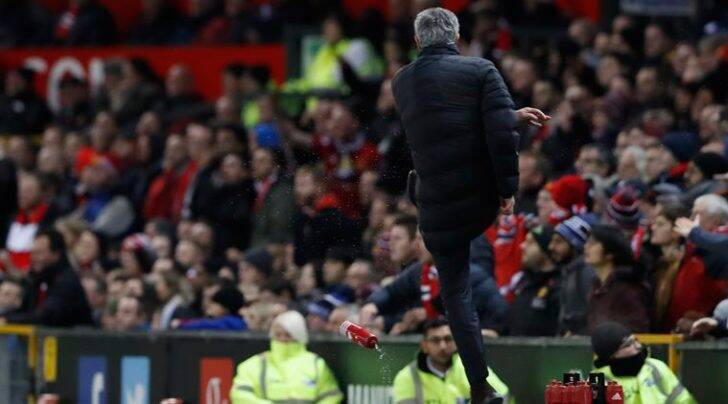 Manchester United manager Jose Mourinho kicks a water bottle