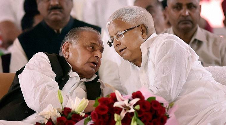 Lucknow: Samajawdi Party supremo Mulayam Singh Yadav sharing a thought with  RJD chief Lalu Prasad Yadav during the Samajwadi Party's  25th Foundation Day celebrations in Lucknow on Saturday. PTI Photo by Nand Kumar(PTI11_5_2016_000142b)