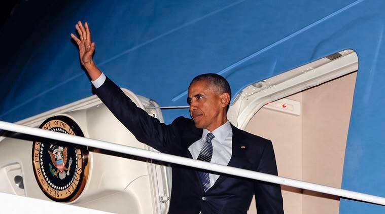 President Barack Obama waves while boarding Air Force One, Monday, Nov. 14, 2016, at Andrews Air Force Base, Md. Obama is traveling overseas and will visit Greece, Germany and Peru. (AP Photo/Pablo Martinez Monsivais)