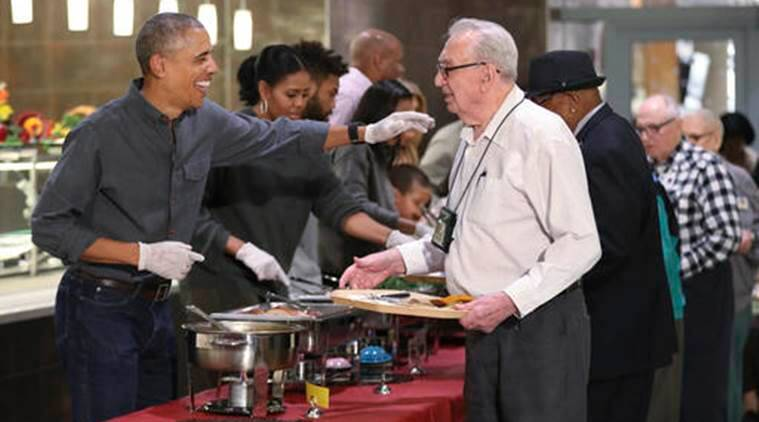 President Barack Obama with first lady Michelle Obama and some relatives serve Thanksgiving meals to residents of the Armed Forces Retirement Home, in Washington, Wednesday, Nov. 23, 2016. (AP Photo/Manuel Balce Ceneta)