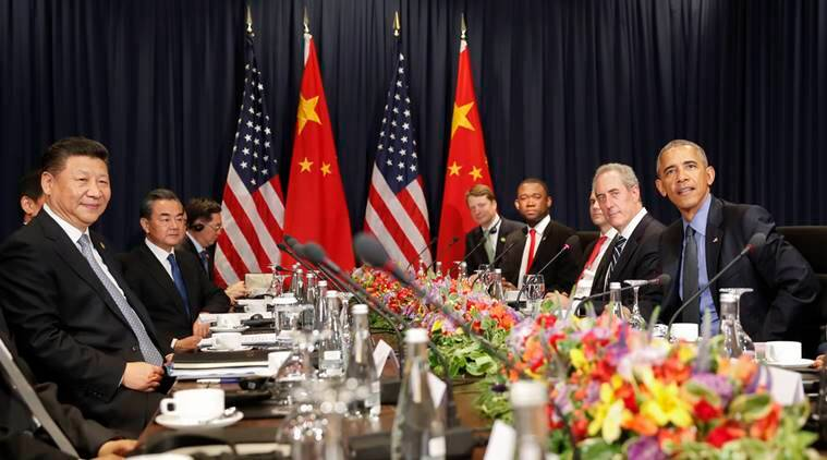 US President Barack Obama, right, with China's President Xi Jingping, left, and members of their delegations, during their meeting as part of the Asia-Pacific Economic Cooperation (APEC) in Lima, Peru. Saturday, Nov. 19, 2016. Obama will close a three-nation, post-U.S. election tour the same way he opened it: by reassuring leaders from around the world that U.S. democracy isn't broken and that everything will be fine when Republican Donald Trump succeed him next year. (AP Photo/Pablo Martinez Monsivais)