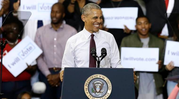 President Barack Obama smiles at the crowd while campaigning for Democratic presidential candidate Hillary Clinton, Friday, Nov. 4, 2016, at Fayetteville State University in Fayetteville, N.C. (AP Photo/Gerry Broome)