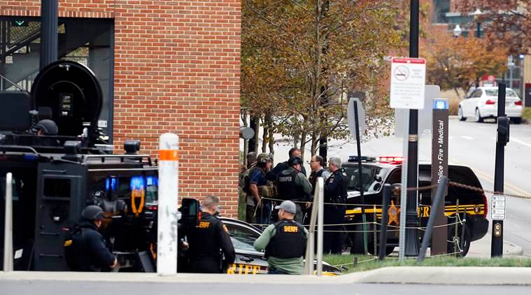 Law enforcement officers work around a parking garage in response to an attack on the campus of Ohio State University on Monday, Nov. 28, 2016, in Columbus, Ohio. (AP Photo/Jay LaPrete)