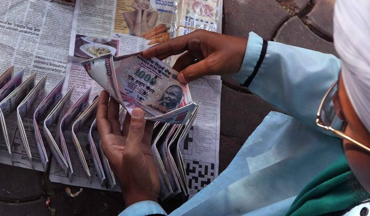 500 and 1000 rupee notes printed as Chinese novelty wallets priced at Rs 20 - 30 at Crawford Market, Mumbai. Express photo by Ganesh Shirsekar, 20th November, 2016, Mumbai.