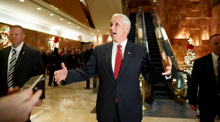 Vice President-elect Mike Pence talks with reporters as he leaves Trump Tower, Monday, Nov. 28, 2016, in New York. (AP Photo/Evan Vucci)