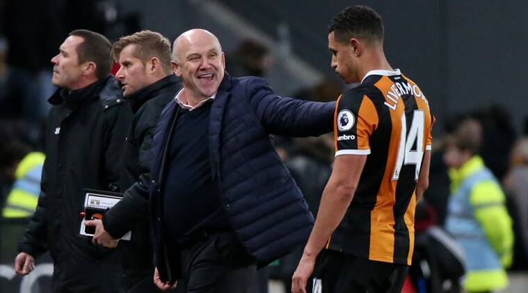 "Britain Football Soccer - Hull City v Southampton - Premier League - The Kingston Communications Stadium - 6/11/16 Hull City manager Mike Phelan celebrates after the game with Jake Livermore Reuters / Scott Heppell Livepic EDITORIAL USE ONLY. No use with unauthorized audio, video, data, fixture lists, club/league logos or ""live"" services. Online in-match use limited to 45 images, no video emulation. No use in betting, games or single club/league/player publications. Please contact your account representative for further details."