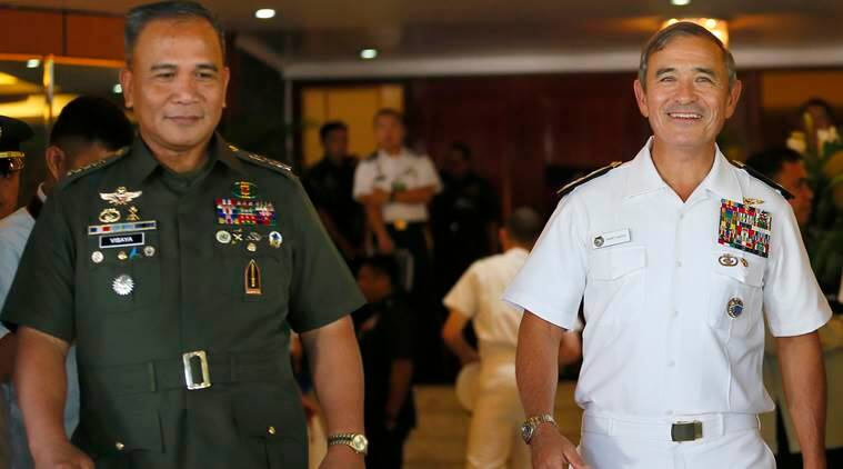 U.S. Admiral Harry Harris, right, U.S. Commander of the U.S.Pacific Command, and Philippine Armed Forces Chief Gen. Ricardo Visaya emerge together following their two annual Mutual Defense Board meeting at Camp Aguinaldo in suburban Quezon city, northeast of Manila, Philippines Tuesday, Nov. 22, 2016. The annual meeting came at a time when Philippine President Rodrigo Duterte ordered the scaling down joint military exercises and other activities between the two countries. (AP Photo/Bullit Marquez)