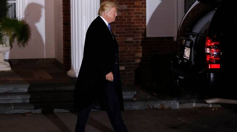 President-elect Donald Trump walks to his motorcade vehicle as he leaves the Trump National Golf Club Bedminster clubhouse Sunday, Nov. 20, 2016, in Bedminster, N.J., after a day of meetings. (AP Photo/Carolyn Kaster)