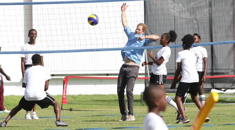 Britain's Prince Harry, center, plays volleyball with a group of youths at the Sir Vivian Richards cricket grounds in Antigua and Barbuda, Monday, Nov. 21, 2016. Prince Harry is in a two week tour of Commonwealth countries in the Caribbean. (AP Photo/Johnny Jno-Baptiste)