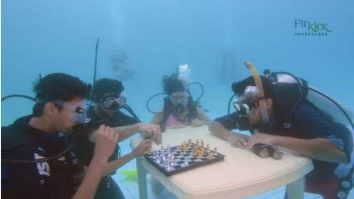 Play games underwater like chess, polo and hockey.