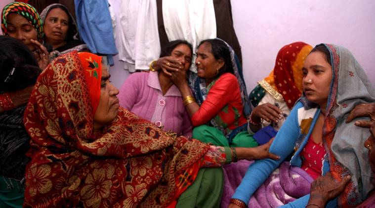 BSF Jawans wife Sunita (wearing nose pin) surrounded by relatives consoling her on Monday .November 21, 2016: Express Photo