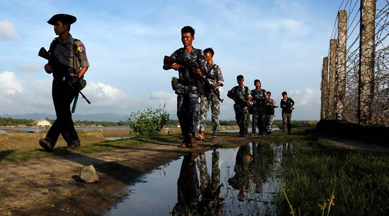 "In this Friday, Oct. 14, 2016 photo, Myanmar police officers patrol along the border fence between Myanmar and Bangladesh in Maungdaw, Rakhine State, Myanmar. Just five months after her party took power, Myanmar's Nobel Peace Prize-winning leader, Aung San Suu Kyi, is facing international pressure over recent reports that soldiers have been killing, raping and burning homes of the country's long-persecuted Rohingya Muslims. The U.S. State Department joined activist and aid groups in raising concerns about new reports of rape and murder, while satellite imagery released Monday, Oct. 31, by Human Rights Watch shows that at least three villages in the western state of Rakhine have been burned. Myanmar government officials deny the reports of attacks, and presidential spokesman Zaw Htay said Monday that United Nations representatives should visit ""and see the actual situation in that region."" (AP Photo/Thein Zaw)"
