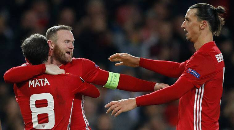Manchester United's Juan Mata celebrates scoring their second goal with Wayne Rooney and Zlatan Ibrahimovic