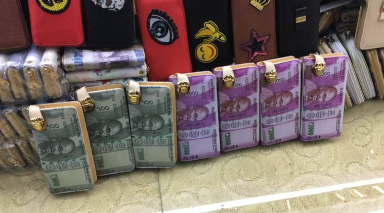 The viral image of purses circulating on social media with pictures of Rs 500 and Rs 2000 notes on them.(Source: Amit Singh/ Twitter)