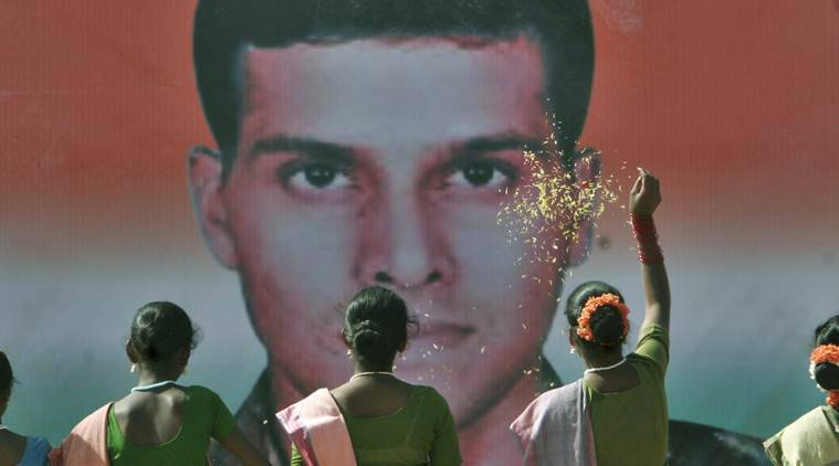 School children pay floral tributes to Major Sandeep Unnikrishnan of the National Security Guard who was killed in the Mumbai terror attacks.