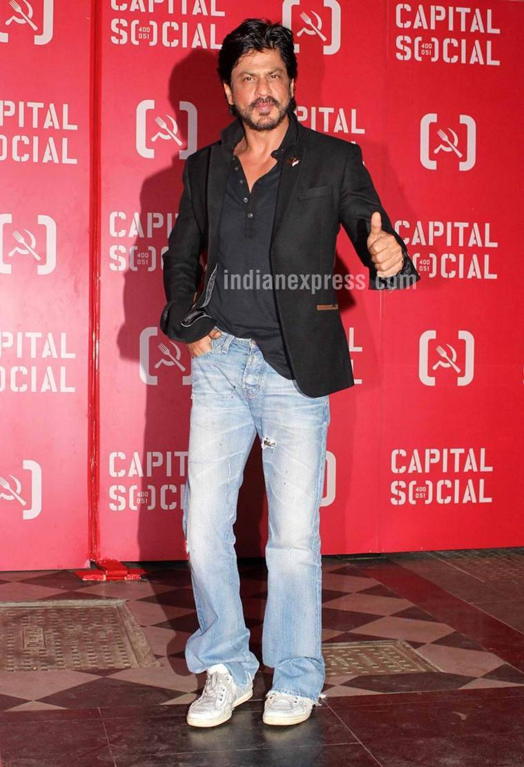 No one does a buttoned-down shirt and baggy denims look better than Shah Rukh Khan. (Source: Varinder Chawla)