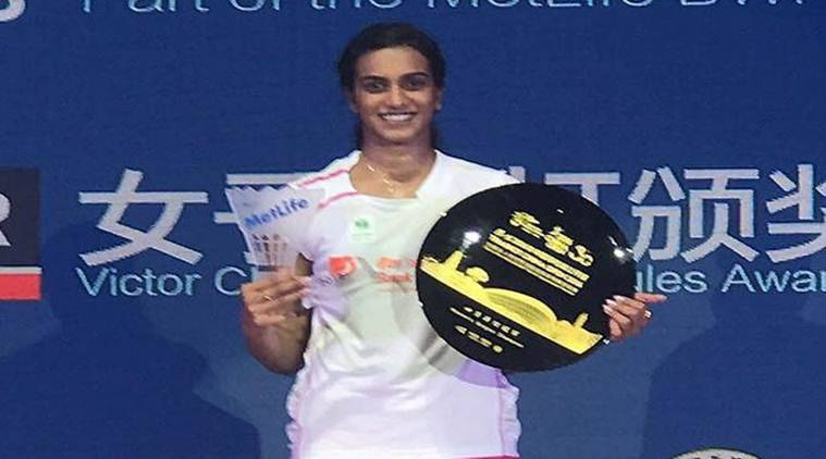 Pusarla Venkata Sindhu poses with trophy