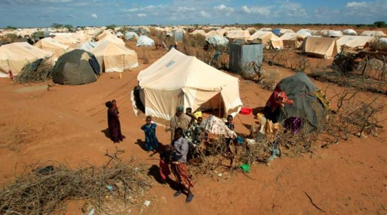 Refugees stand outside their tent at the Ifo Extension refugee camp in Dadaab, near the Kenya-Somalia border in Garissa County, Kenya. (Source: Reuters photo)