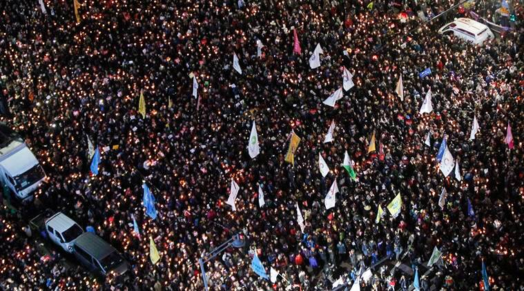 Protesters march toward presidential house after a rally calling for South Korean President Park Geun-hye to step down in Seoul, South Korea. (AP Photo/Ahn Young-joon, File)