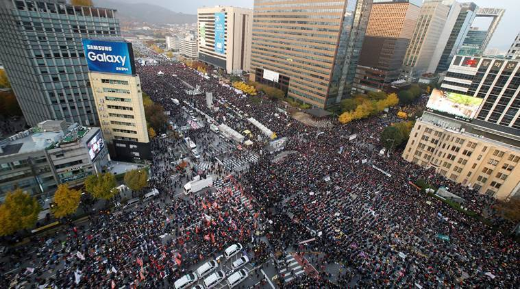 People take part in a rally calling for President Park Geun-hye to step down in central Seoul, South Korea, November 12, 2016. REUTERS/Kim Hong-Ji