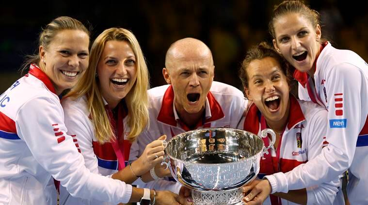 Czech Republic team captain Petr Pala, center, and players hold the trophy after their victory against France, during the Fed Cup final in Strasbourg, eastern France, Sunday, Nov. 13, 2016. Czech Republic retains Fed Cup title by beating France 3-2. (AP Photo/Jean-Francois Badias)