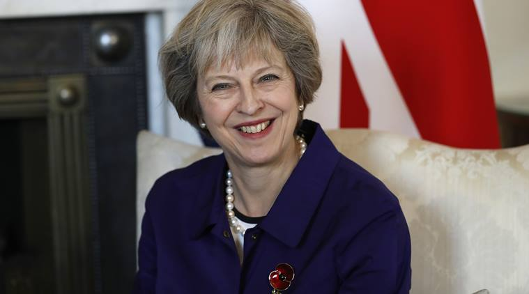British PM, Theresa May, poppy ban, poppy ban football, what are poppies, poppy armbands, football armbands, football, football news, sports, sports news