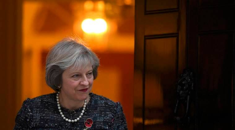Britain's Prime Minister Theresa May waits to greet Hungary's Prime Minister Viktor Orban at Downing Street in London, Britain, November 9, 2016. REUTERS/Toby Melville