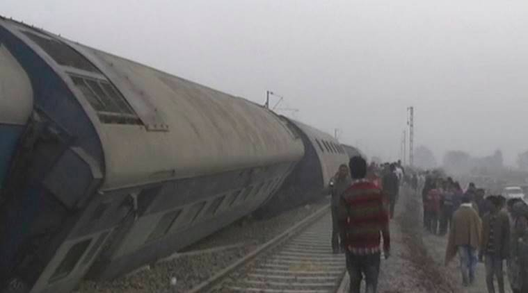 In this image made from video, people gather at the site of a train accident near Pukhrayan, about 270 kilometers (168 miles) from Allahabad, Sunday, Nov. 20, 2016. Rescue workers used gas cutters to pull out survivors after 14 coaches of a passenger train rolled off the track in northern India early Sunday, police said. (KK Productions via AP)