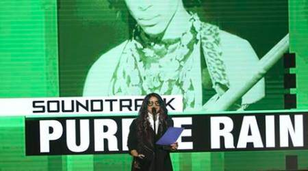 """Tyka Nelson accepts the award for top soundtrack for """"Purple Rain"""" on behalf of her brother Prince at the American Music Awards at the Microsoft Theater on Sunday, Nov. 20, 2016, in Los Angeles. (Photo by Matt Sayles/Invision/AP)"""