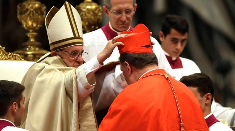 New Cardinal Joseph William Tobin, Archbishop of Indianapolis, receives the red three-cornered biretta hat during a consistory inside the St. Peter's Basilica at the Vatican, Saturday, Nov. 19, 2016. In the ceremony to formally give the Catholic church 17 new cardinals, Francis lamented how immigrants, refugees, and those from different races or faiths are increasingly seen as enemies. (AP Photo/Gregorio Borgia)