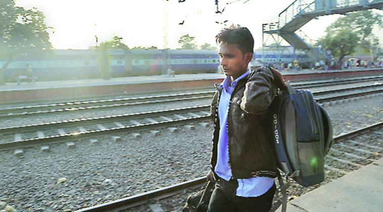 Umesh waits for his train at Adarsh Nagar railway station. Express Photo by Abhinav Saha