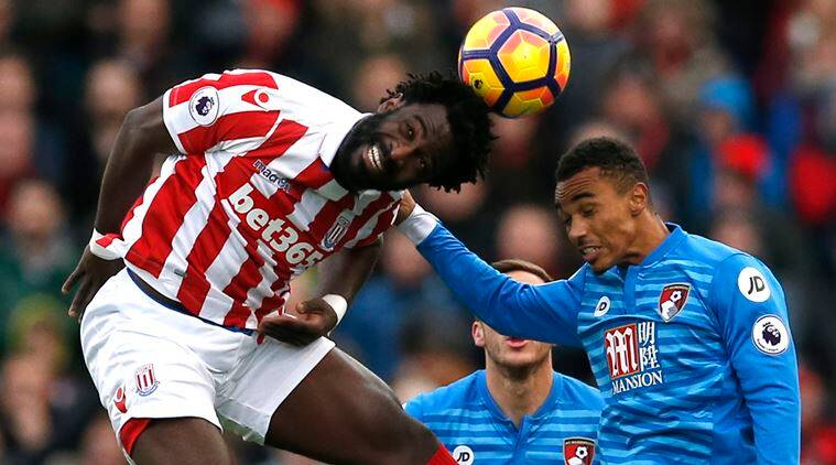 Bournemouth's Junior Stanislas in action with Stoke City's Wilfried Bony