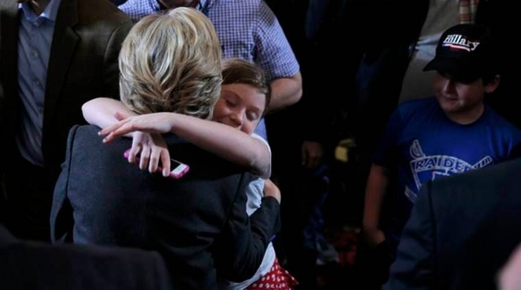 Hillary Clinton hugs a young girl as she greets members of her staff and supporters after speaking about the results of the U.S. election at a hotel in the Manhattan borough of New York, U.S., November 9, 2016.     REUTERS/Brian Snyder