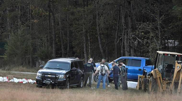 As the sun rises Friday, Nov. 4, 2016, crews gather at the Wofford Road property in Woodruff, S.C., to continue an investigation where a missing woman was found Thursday chained in a large storage container. (Heidi Heilbrunn /The Greenville News via AP)