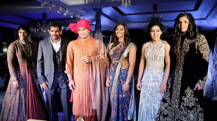 From L to R: Wrestler Babita Phogat, Yogeshwar Dutt, WWE Champion Great Khali, Geeta Phogat, Sakshi Malik at a fashion show during the announcement of 2nd session of Pro Wrestling League (PWL) in New Delhi. (Source: PTI)