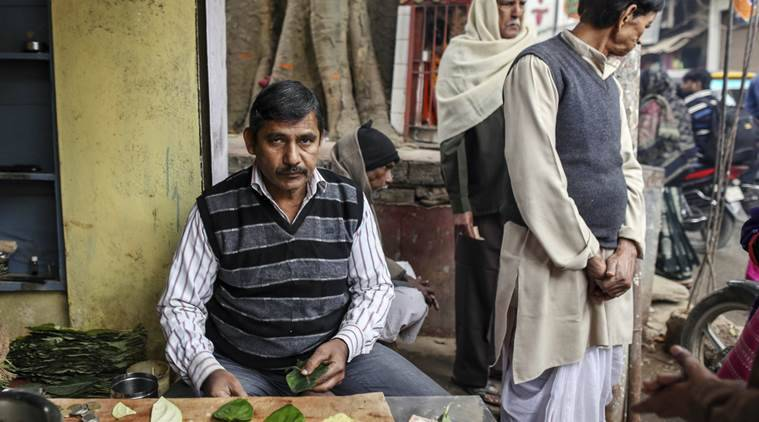 Ravindra Chaurasia, 54, betel leaf seller poses for photograph at his shop  at Assi