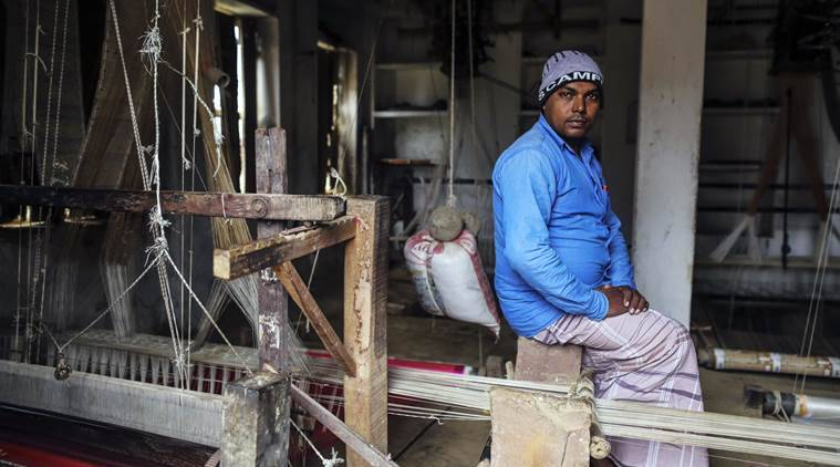 Zainul Abedin, 39, weaver, poses for photograph inside his handloom at  Kotwa village