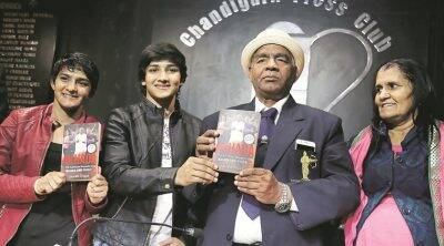 Mahavir Phogat, Mahavir Phogat book, Mahavir Phogat biography, Geeta Phogat, Geeta Phogat book, wrestling gold medalist, Phogat wrestling gold medalist, wrestling gold medalist book, New Delhi, book, Indian Express