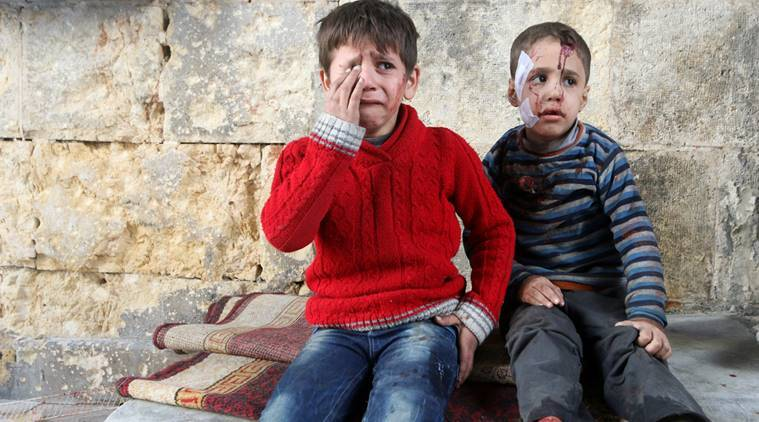 Injured boys react at a field hospital after airstrikes on the rebel held areas of Aleppo, Syria November 18, 2016. REUTERS/Abdalrhman Ismail