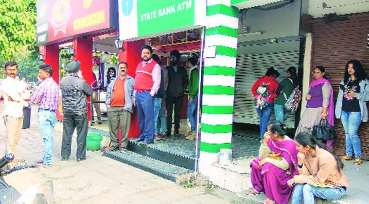 People waiting outside an ATM in Mohali on Tuesday. Jasbir Malhi