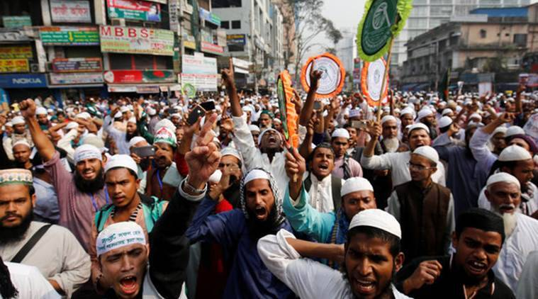 Bangladeshi Muslim activists of an Islamic group shout slogans as they gather in front of Baitul Muqarram National Mosque to protest against the deaths of Rohingya Muslims in the Rakhine state of Myanmar, in Dhaka, Bangladesh, December 18, 2016. REUTERS/Mohammad Ponir Hossain