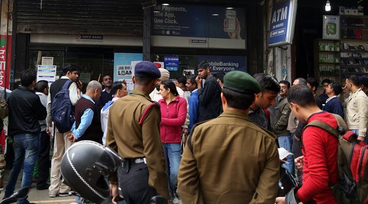 People stand outside a bank at Delhi Cantt to make withdrawals on Thursday. (Source: Express photo by Renuka Puri)