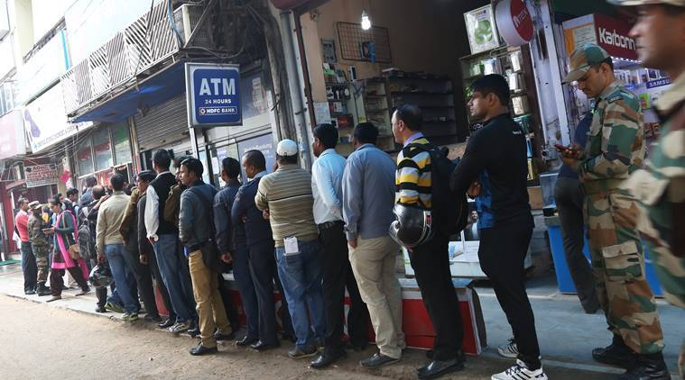 People queue up outside at HDFC Bank at Delhi Cant on Thursday. Express photo by Renuka Puri, 1st Dec. 2016.