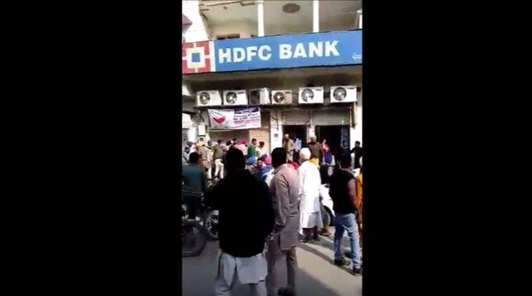 A crowd of people outside the HDFC bank in Punjab