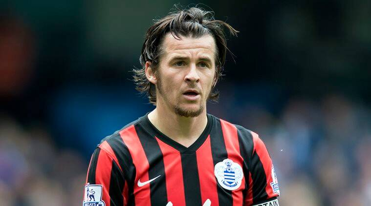 FILE - In this Sunday, May 10, 2015 file photo, Queens Park Rangers' Joey Barton watches the ball during their English Premier League soccer match at the Etihad Stadium, Manchester, England. After a short and ill-fated stint in Scottish football, Joey Barton is back in the English Premier League with former club Burnley. Burnley said Tuesday, Dec. 20, 2016 that the 34-year-old Barton has agreed to a deal until the end of the season, subject to international clearance when the transfer window opens in January. (AP Photo/Jon Super, file)