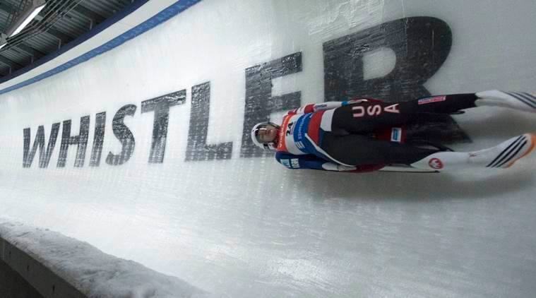 Summer Britcher of the United States slides during a women's World Cup Luge event, Saturday, Dec. 10, 2016 in Whistler, British Columbia. (Jonathan Hayward/The Canadian Press via AP)